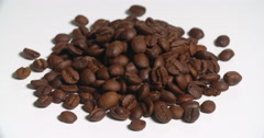 Coffee Beans Pile Uncooked Spinning on White Stock Footage