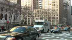 UPS truck passes in front of NY Public Library on Fifth Ave., pan Stock Footage
