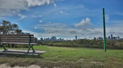 City Park Bench with Blue Skies and Toronto Skyline - Time Lapse Stock Footage