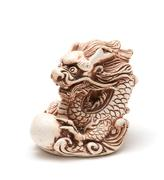 Netsuke of east dragon, which guarding the egg. Isolated Stock Photos