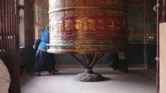 Women spinning praying wheel,Kathmandu,Boudhanath,Nepal Stock Footage