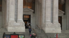 Tilt from stairs & entrance to columns & NY Public Library lettering on facade Stock Footage