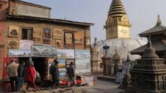 Souvenir stall selling paintings,Kathmandu,Swayambhunath,Nepal Stock Footage