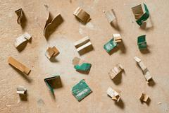 Pieces of Used Crumpled Sandpaper Arranged in a Grid Stock Photos