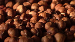 Dried peeled hazelnuts rotation with play of natural sun. 4K Stock Footage