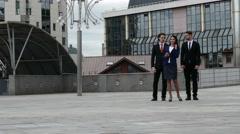 Business team walking outside office Stock Footage
