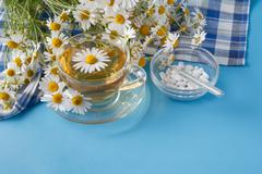 Tea,pills and thermometer Stock Photos