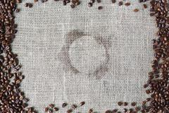 Burlap texture with coffee beans border - stock photo