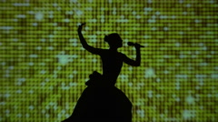 Silhouette of a beautiful Finnish singer with microphone in hand Stock Footage