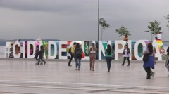 Olympics Sign in Rio with People Walking Stock Footage