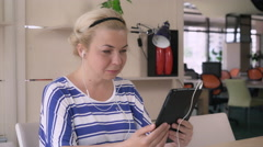 Female talk on touch screen tablet with friend Stock Footage