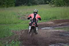 Motorcyclist overcomes the track to compete in motocross. Sport Stock Photos