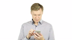 Young handsome  freelancer man using smartphone - stock footage