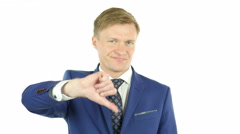 Sad businessman showing thumbs down on White Background Stock Footage