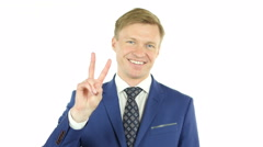 Happy businessman victory gesture on white background Stock Footage