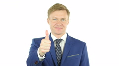 Successful businessman with thumb up Stock Footage