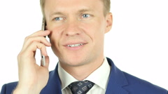 Businessman Talking on Phone, Portrait with white background Stock Footage