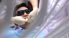 There is view through decoration on dentist making teeth mold for prosthetics Stock Footage