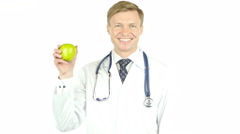 Importance of health. doctor Shows Green Apple Stock Footage