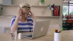 Ill girl at the working space wearing in casual top - stock footage