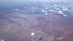 AERIAL: Flying high over winding zigzag course of river in dry desert landscape Stock Footage