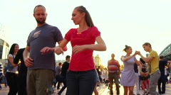 RUSSIA, MOSCOW, 10 JUL 2016: Dance training outdoors. Couples dancing at street Stock Footage