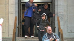 Visitors get out of the NY Public Library through revolving door Stock Footage