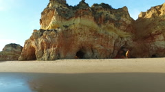 Natural rocks and ocean at Praia tres Irmaos in Alvor Portugal - stock footage