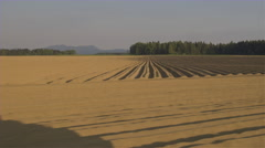 AERIAL: Empty soil lines on a plowed agricultural farmland prepared for planting - stock footage