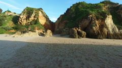 Natural rocks and ocean at Praia tres Irmaos in Alvor Portugal Stock Footage