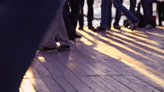 Couples perform Latin dances in the street. Close-up of feet of a dancing couple Stock Footage