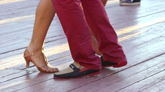 Couple perform Latin dances in the street. Close-up of feet of a dancing couple Stock Footage