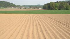 AERIAL: Empty plowed soil lines on farming field prepared for crop planting Stock Footage
