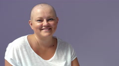 Cancer patient. Woman with cancer is smiling to camera Stock Footage