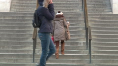 Visitors get in and out of NY Public Library, using stairs and revolving door Stock Footage