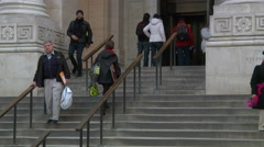 Tilt shows visitors getting in and out of NY Public Library, wider Stock Footage