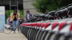 Large number of parked bicycle for rent in the city, public transportation Stock Footage