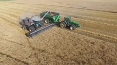 Gleaner Combine and Grain Cart  - Drone Stock Footage