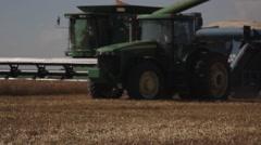 Wheat Harvest John Deere Combine and Grain Cart  Stock Footage