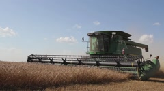 Wheat Harvest John Deere Combine Ground Shot Side View3 Stock Footage