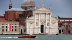 Venice's Church of San Giorgio Maggiore with a water taxi in the foreground Stock Footage