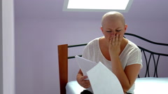 Woman with cancer receiving bad medical test results - stock footage