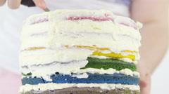 Coating rainbow cake with cream all around closeup 4K Stock Footage