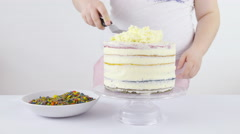 Creaming cream over tasty cake top layer 4K - stock footage