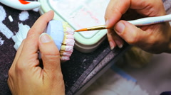 Dental technician making teeth for false dental prosthesis Stock Footage