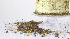 Chocolate sprinkles lying around cake 4K Stock Footage