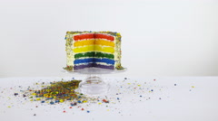 Finished rainbow cake with missing slice dolly sliding 4K - stock footage