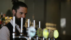 4K Bartender in city bar pouring and serving drinks for young couple Stock Footage
