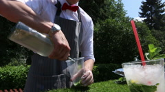 Bartender Making Mojito Cocktail: effectively pours syrup for mojito in a glass Stock Footage
