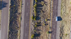 Aerial of a passing semi truck and cars on an interstate highway Stock Footage